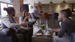 Group Of Friends Meeting For Coffee In Bar Shot On R3D Stock Footage