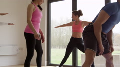 Instructor With Yoga Class At Gym Shot On R3D Stock Footage