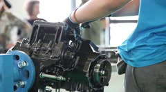 Mechanic working on a motorcycle engine, slider shot Stock Footage