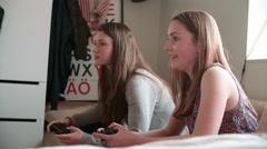 Two Teenage Girls Playing Video Game In Bedroom Stock Footage