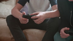 Close Up Of Two Teenage Boys Playing Video Game In Bedroom Stock Footage