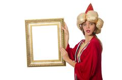 Woman wizard in red clothing isolated on white - stock photo