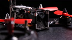 Racing drone quadcopter FPV with remote control transmitter - stock footage