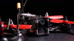 Drone racing multirotor quadcopter with remote control transmitter - stock footage