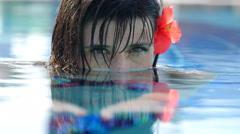 Girl mermaid in the pool looks fascinating Stock Footage