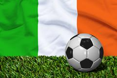 Soccer Ball on Grass with Ireland Flag Background, 3D Rendering Stock Illustration
