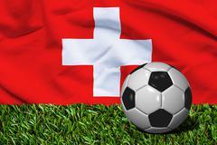 Soccer Ball on Grass with Switzerland Flag Background, 3D Rendering - stock illustration