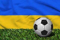 Soccer Ball on Grass with Ukraine Flag Background, 3D Rendering Stock Illustration