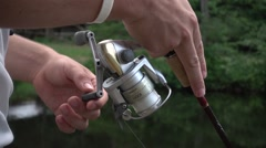 Summer Time Lake Fishing Reel Slow Motion Stock Footage