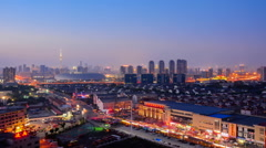 Cityscape of Tianjin city China at twilight dusk night. Aerial perspective. Stock Footage