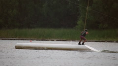 Athlete wakeboarder jumping on trampolines Stock Footage