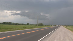 Tornado warned thunderstorm rolling in near city Stock Footage