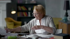 Elderly woman worries about bills. she understands that all is well. calms down Stock Footage