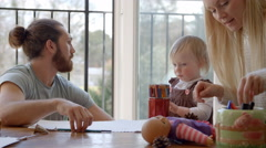 Family Sitting At Table And Drawing Pictures Together Stock Footage