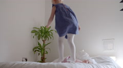 Sisters Having Fun Jumping On Parents Bed In Slow Motion Stock Footage