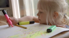 Girl Sitting At Table And Drawing Picture In Slow Motion Stock Footage