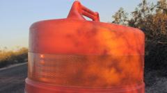 Tilt to Reveal Orange Traffic Barrel Stock Footage