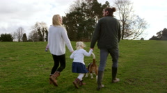 Family On Winter Country Walk With Pet Dog Shot On R3D Stock Footage