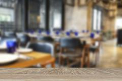 Wooden table for display or montage your product with blur background of cafe Stock Photos