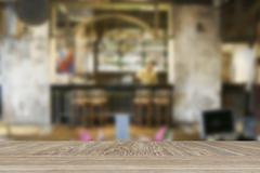 Wooden table for display or montage your product with blur background of glas Stock Photos