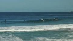surfers at ipanema beach in rio de janeiro - stock footage