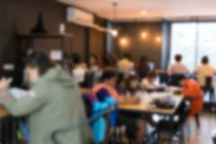 blurry defocused image of people working in cafe - stock photo