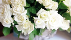 Beautiful bouquet of white roses in a vase - stock footage