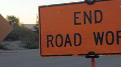 "Pan to Reveal ""End Road Work"" Safety Sign Stock Footage"