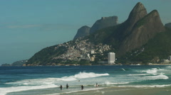 surfers paddling out at ipanema beach in rio de janeiro - stock footage