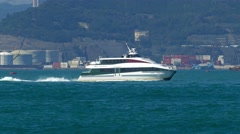 High-speed ferry boat in harbor of Hong Kong Stock Footage