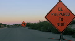 Two Road Hazard Signs Warn Motorists of Construction Ahead Stock Footage