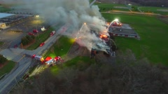 Gliding motion in flight above large school blaze Stock Footage