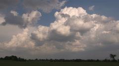 Dark ominous cumulonimbus thunderstorm clouds building Stock Footage