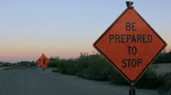 Tilt to Reveal a Be Prepared to Stop Sign Stock Footage
