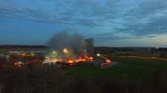 Slow altitude drone flight towards large school fire Stock Footage