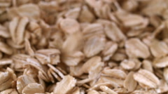 Rolled oats slowly poured onto pile, close up. Stock Footage