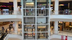 People walking and use escalator for for shopping at shopping mall - stock footage