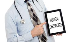 Doctor holding tablet - Medical certificate - stock photo
