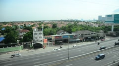 View of Nonthaburi city from MRT Purple Line skytrain running go to Bangkok Stock Footage