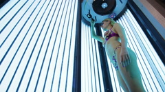 Beautiful girl in swimsuit at solarium Stock Footage