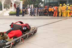 paramedic and stretcher gurney in mock disaster drill - stock photo