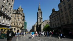 Many tourists walking and shopping at High Street in Edinburgh Stock Footage