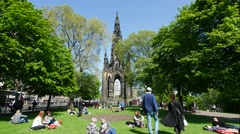 Princes Street garden with Scott Monument full of people Stock Footage
