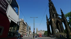 Traffic at Princes Street garden with Scott Monument full of people Stock Footage