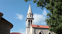 Bell tower of old town is in center of Budva city. Montenegro Stock Footage