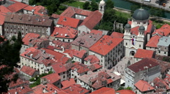 Red roofs of houses of old town of Kotor. View at the Cathedral with square Stock Footage