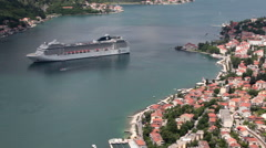 Large contemporary cruise vessel is in center of Bay of Kotor. Montenegro Stock Footage