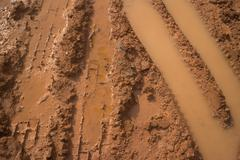 Close up of muddy vehicle and tire tracks on a construction site Stock Photos
