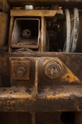 Vertical MCU abstract section of construction machine showing bolts and vents - stock photo