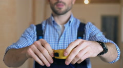 Worker using measuring tape in a new house - stock footage